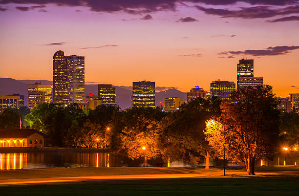 denver skyline at sunset with an orange to purple sky - skyline mountains usa stock photos and pictures
