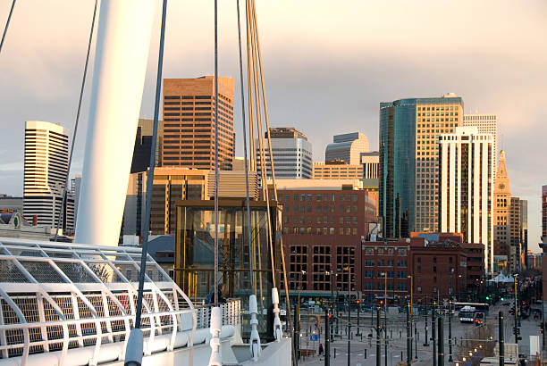 denver skyline in from lower downtown - low section stock photos and pictures