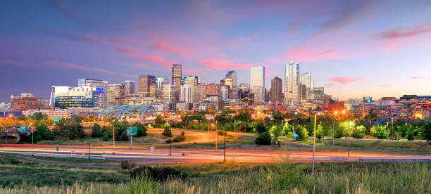 Denver skyline long exposure at twilight. Panorama of Denver skyline long exposure at twilight. denver stock pictures, royalty-free photos & images