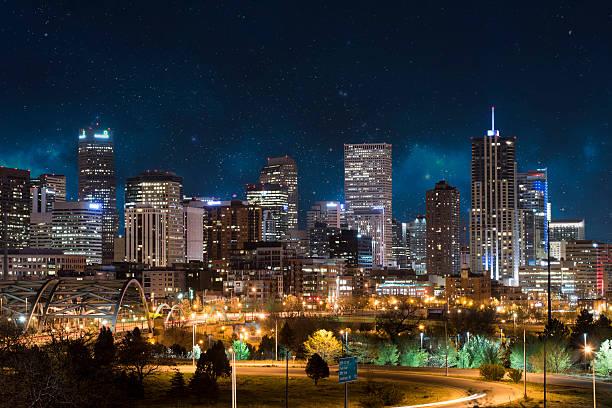 Denver Skyline Denver, Colorado, city skyline under a night sky denver stock pictures, royalty-free photos & images
