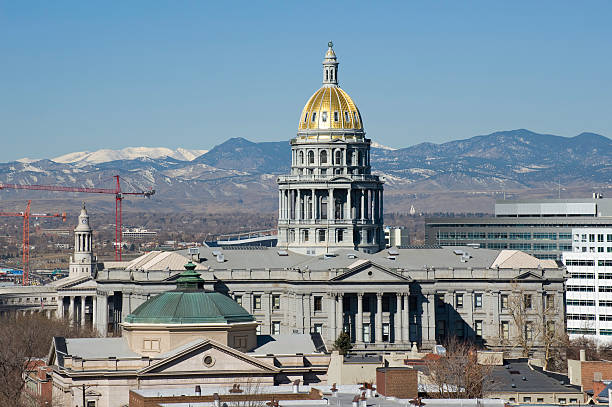 denver state capitol building with mountain view - colorado state capitol stock photos and pictures