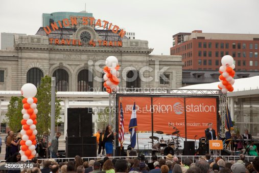 Denver, Colorado, USA - May 9, 2014: Crowds of people gather around the stage and listen to Colorado Governor John Hickenlooper at the grand opening of the Union Station Transit Center in downtown Denver.