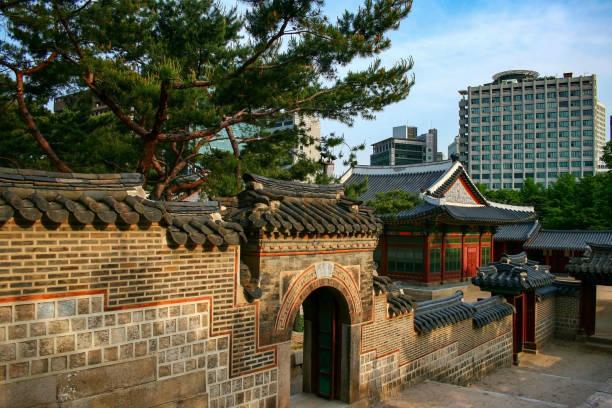 Deoksugung Palace small gate in the surrounding wall, Seoul, South Korea. stock photo