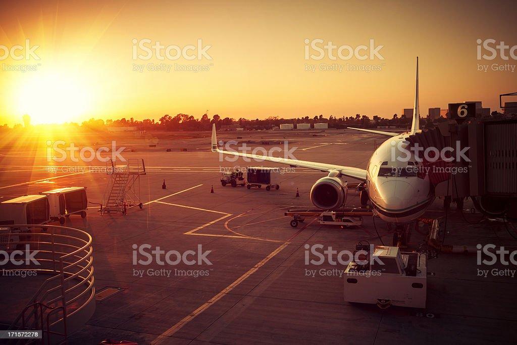 Deparing Airplane in Sunset, Airport stock photo