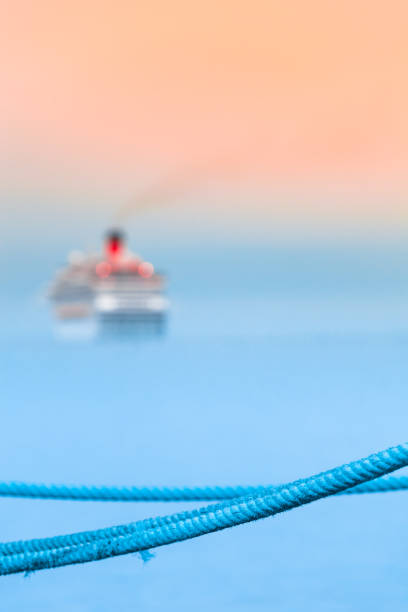 Depart for Cruise Travel Blue rope harbor detail, departed cruise ship at blurred background (copy space) depart stock pictures, royalty-free photos & images