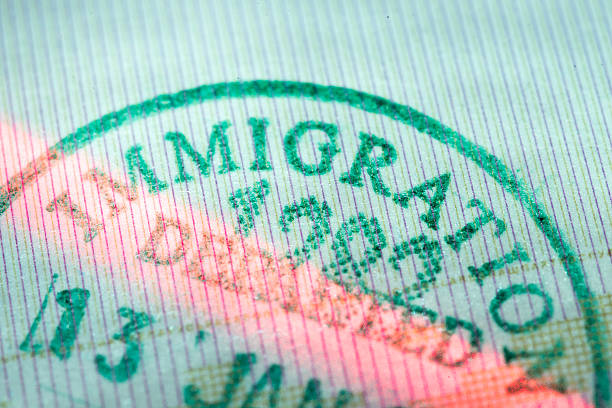departed stamp closeup fragment of immigration departed stamp scanned by laser beam deportation stock pictures, royalty-free photos & images