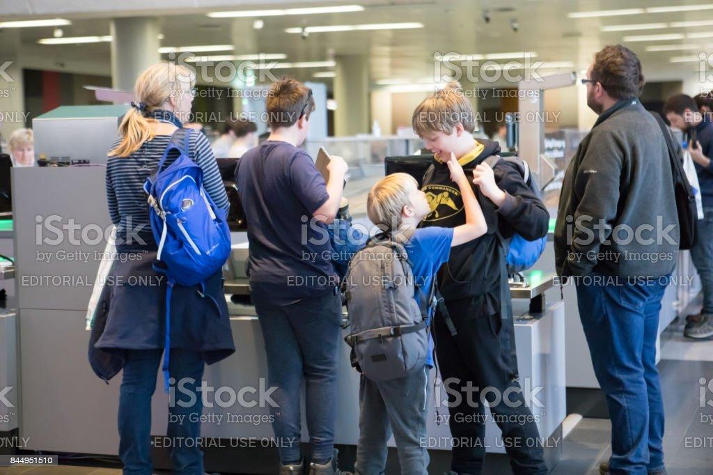 Departing family at TSA security checkpoint at Keflavik International Airport, Iceland stock photo