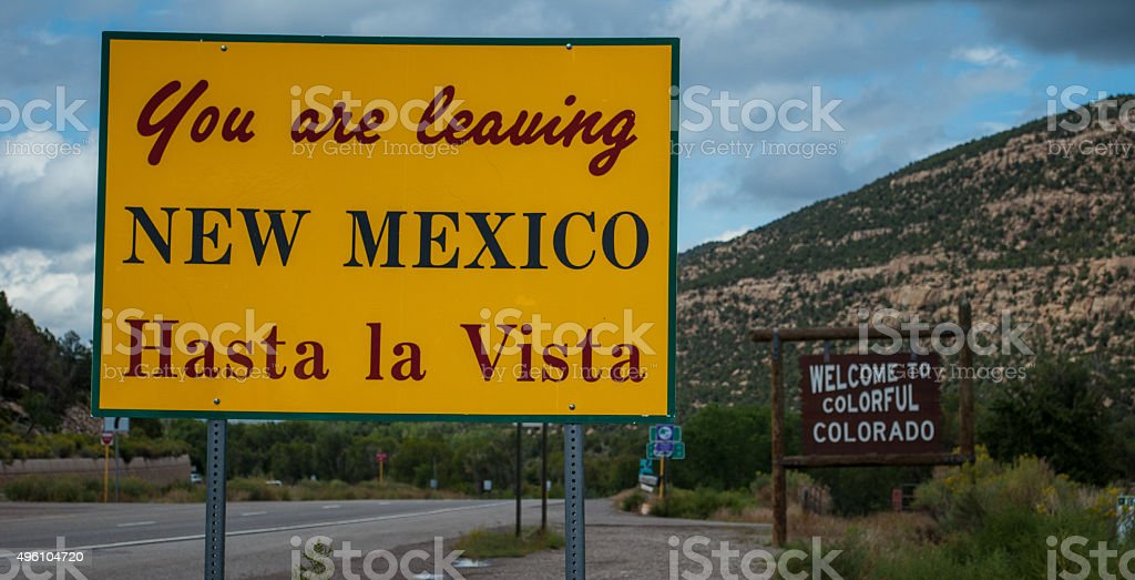 Departing New Mexico Welcome Colorful Colorado Street Sign stock photo