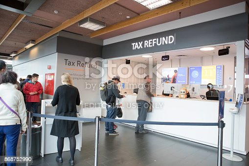 Sandgerdi, Iceland-Aug 26, 2017:  Departing passengers are on line at the Tax Refund counter in Keflavik International Airport. They are getting a Vat tax refund. Vat, a value added tax, is a general consumption tax collected in some countries. When you leave a country in the EU you can get a refund if you are taking the goods purchased with you. Shot taken with Canon 5D Mark lV.