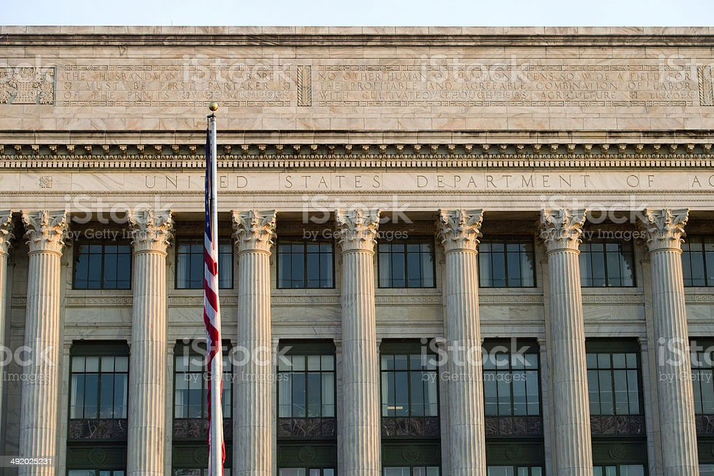 Department of Agriculture office building, American flag stock photo