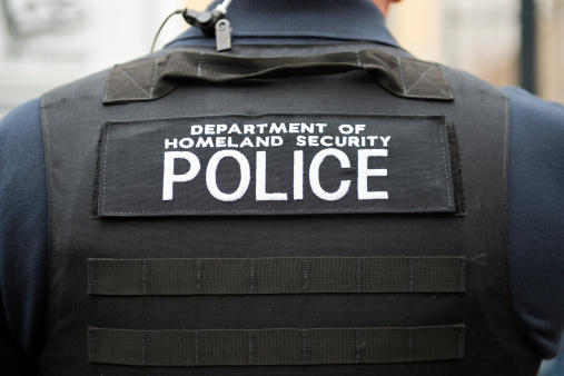 Department Of Homeland Security Vest And Officer Stock Photo - Download Image Now