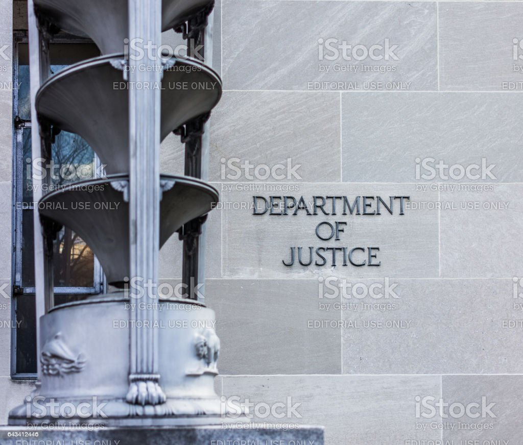 Department of Justice building with sign stock photo