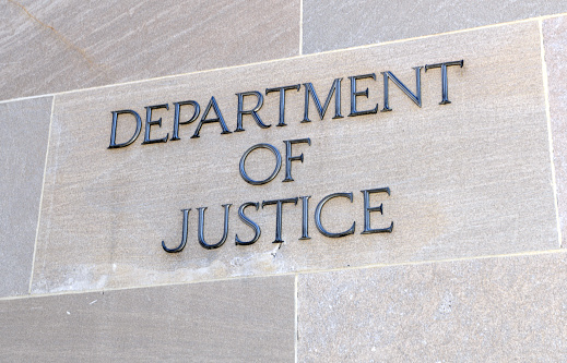 Department of Justice sign, Washington DC, USA. Many law enforcement agencies are administered by the DOJ, including the FBI, DEA and Federal Bureau of Prisons