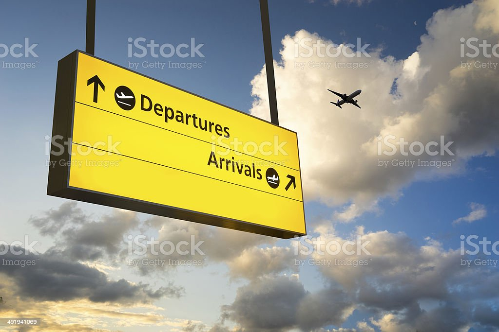 Departure & Arrival sign, Jet Airplane take off airport stock photo