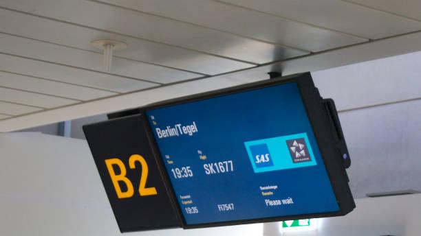 Departure board at gate on Copenhagen airport stock photo