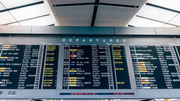 departure board - destination airports - arrival departure board stock photos and pictures