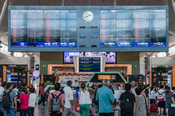 Departure Board in KL International Airport. Departure Hall Malaysia Kuala Lumpur: Departure Board in Kuala Lumpur International Airport 2, AKA KLIA2 in Malaysia capital has 2 Departure Hall one called KLIA and KLIA2 kuala lumpur airport stock pictures, royalty-free photos & images
