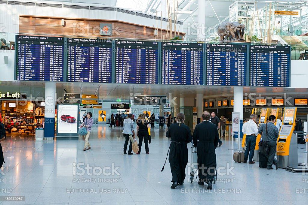 Departure board inside Munich International Airport stock photo