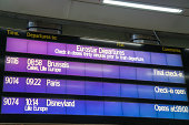 London, United Kingdom - May 27, 2013: Departure information screen at St Pancras railway station terminal in London on the platform. Lists departures of the Eurostar train service going to Eurodisney, Paris and Brussels along the channel tunnel route.