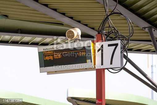 Berlin, Berlin/Germany - 24.03.2019: A digital departure indicator to a bus station in Berlin with loose cables and the departure to Leipzig in the waiting area