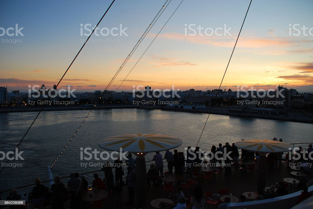 Departure of a Cruise liner, sunset, skyline of Cadiz, Spain royalty-free stock photo