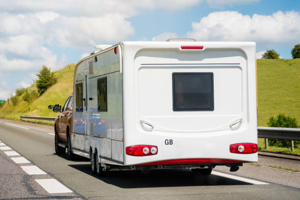 departure or return of holidays with the caravan departure on vacation under the sun manufactured housing stock pictures, royalty-free photos & images