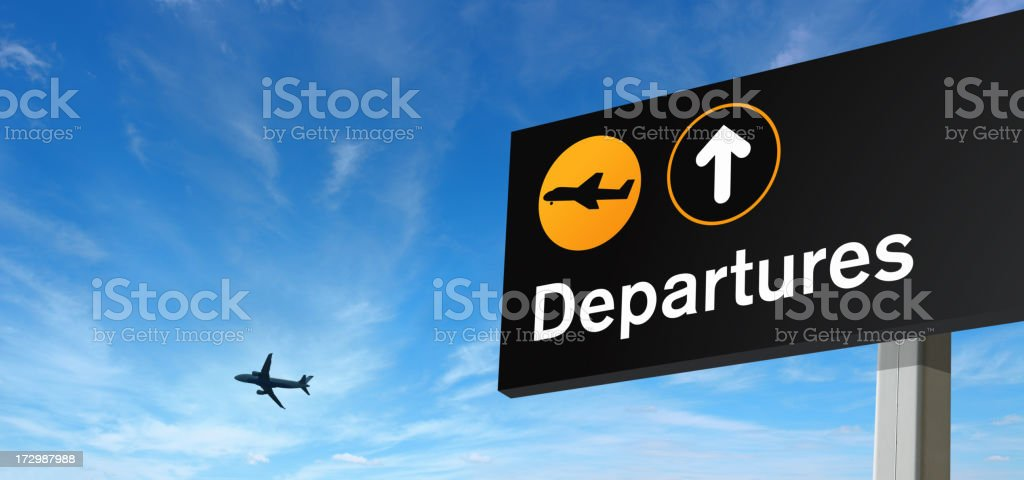 Departure Sign and Airplane on the Sky stock photo