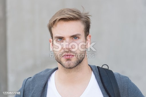 Depends upon your choice. student unshaven face stylish hairstyle. Bearded man casual style. portrait of male attractiveness. young sexy guy gray background. unshaved macho man. fall male fashion.