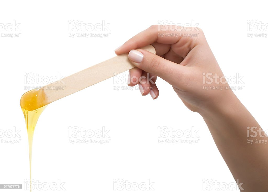 Depilation wax dripping stock photo
