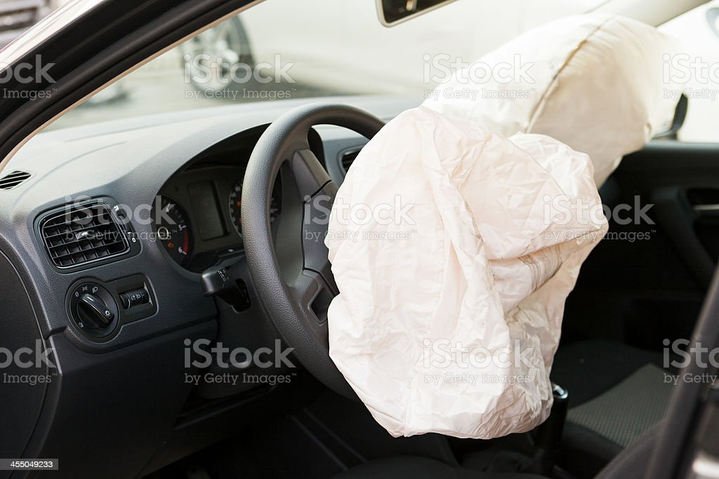 Deployed airbag in the interior of a vehicle stock photo