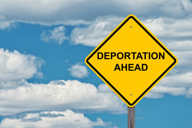 Deportation Ahead Warning Sign Deportation Ahead Caution Sign Blue Sky Background deportation stock pictures, royalty-free photos & images