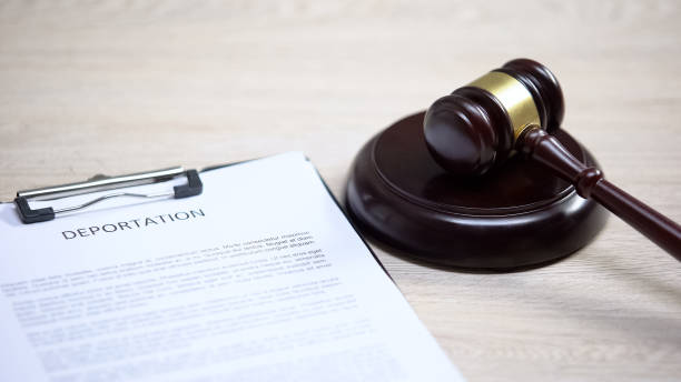 Deportation document on table, gavel lying on sound block, migration law Deportation document on table, gavel lying on sound block, migration law deportation stock pictures, royalty-free photos & images