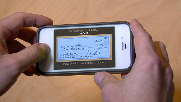 deposit check with cell phone - portable information device stock photos and pictures