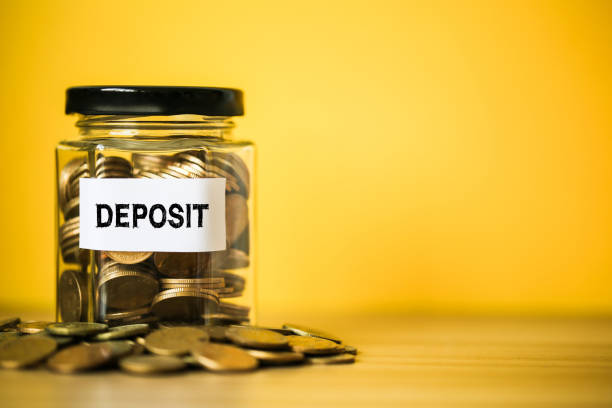 deposit concept glass jar with coins inside - depositor stock pictures, royalty-free photos & images