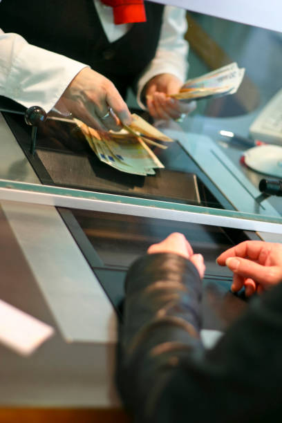 Deposit payment at a bank cashier stock photo