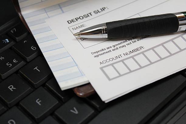 deposit slip - bank deposit slip stock pictures, royalty-free photos & images