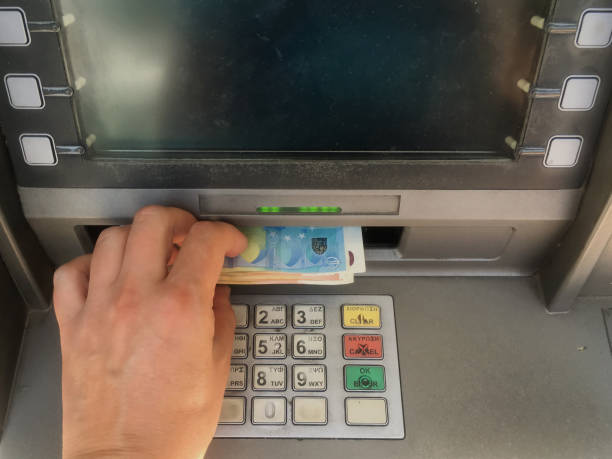 depositor withdraws cash from atm - depositor stock pictures, royalty-free photos & images