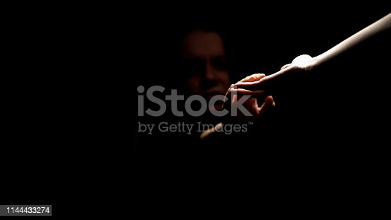 istock Depressed abandoned female taking hand offering help and changes, belief concept 1144433274