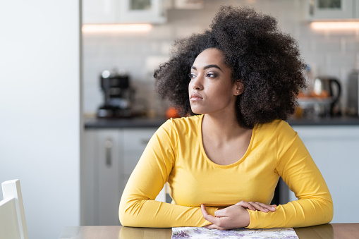 istock Depressed afro woman at home 1153996667