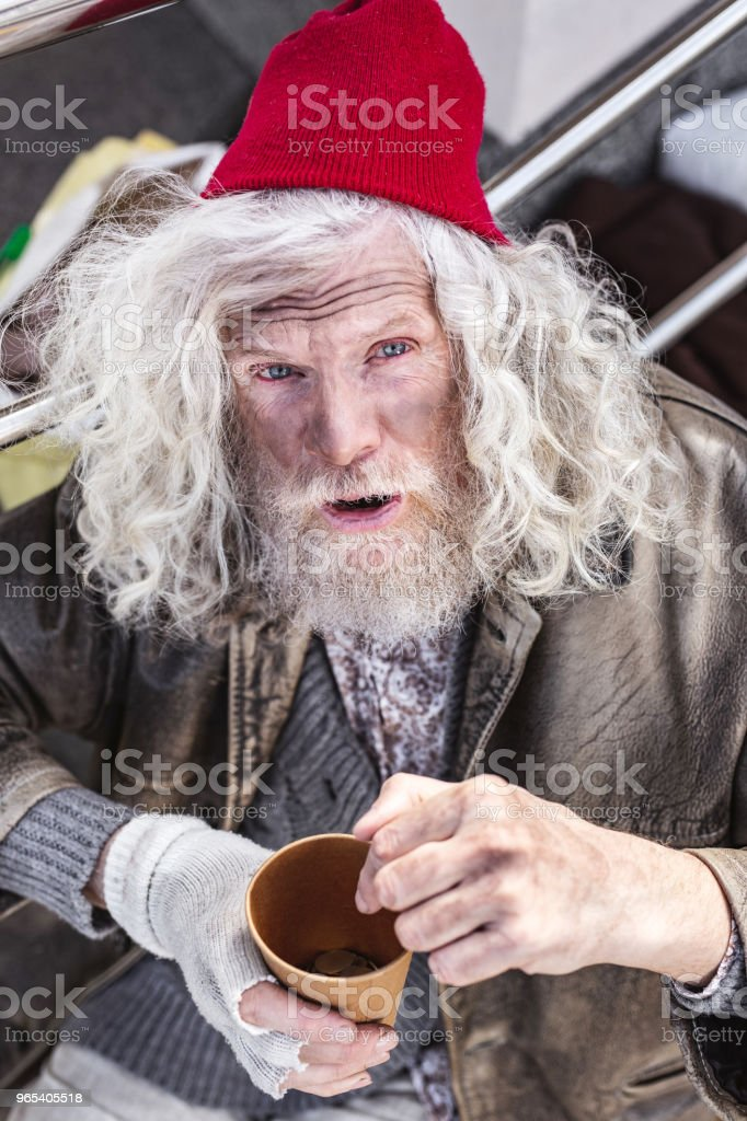 Depressed aged man looking at you zbiór zdjęć royalty-free