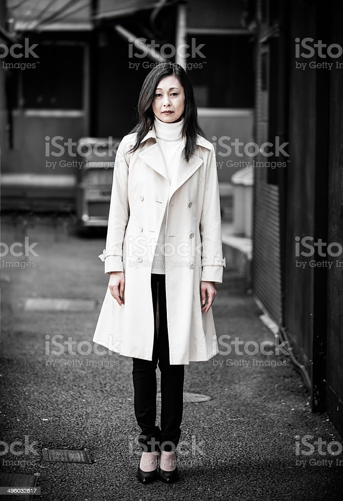 Depressed Asian Woman In dark alley stock photo