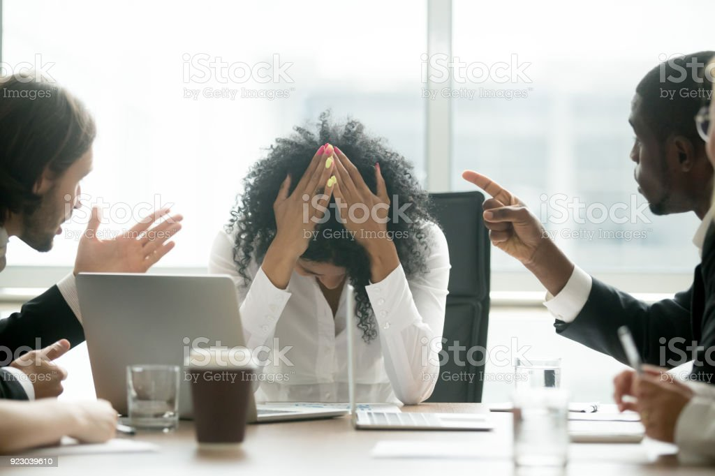 Depressed black woman leader suffering from gender discrimination at work stock photo