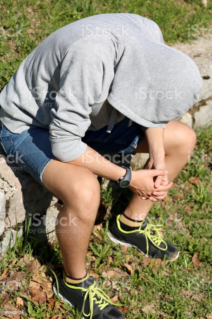 depressed boy with gray sweatshirt and hood royalty-free stock photo