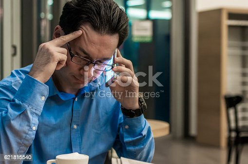 istock Depressed businessman in the coffee shop. Stressed businessman 621815540