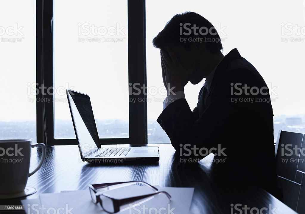 Depressed businessman stock photo