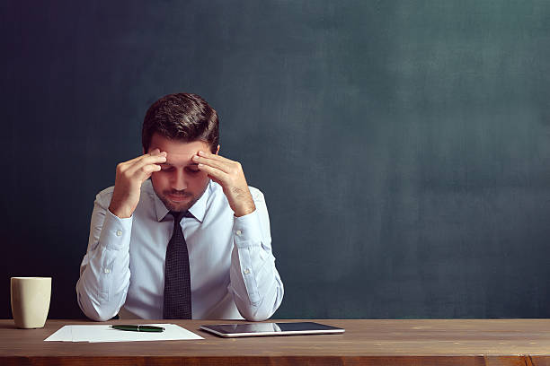 depressed businessman - worried stock pictures, royalty-free photos & images