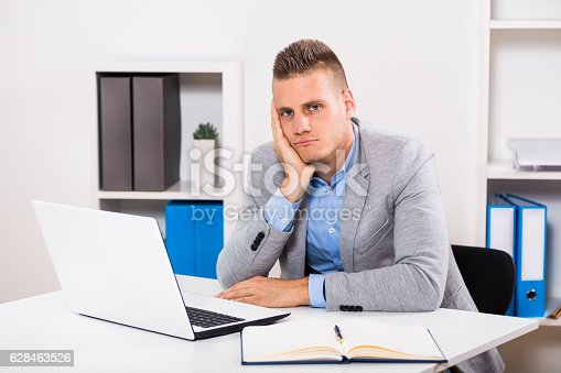 istock Depressed businessman 628463526