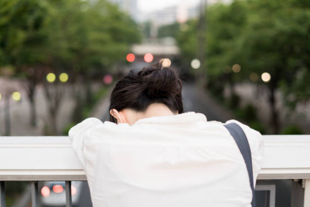depressed businesswoman - asia orientale foto e immagini stock