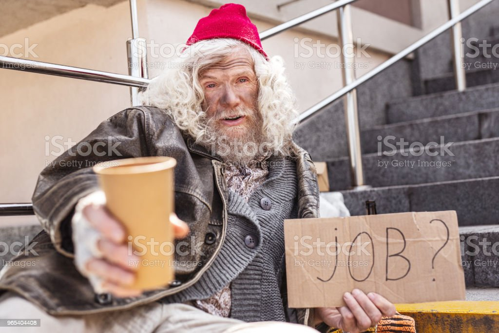 Depressed cheerless man holding a cup zbiór zdjęć royalty-free