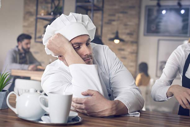 depressed chef - chef triste foto e immagini stock